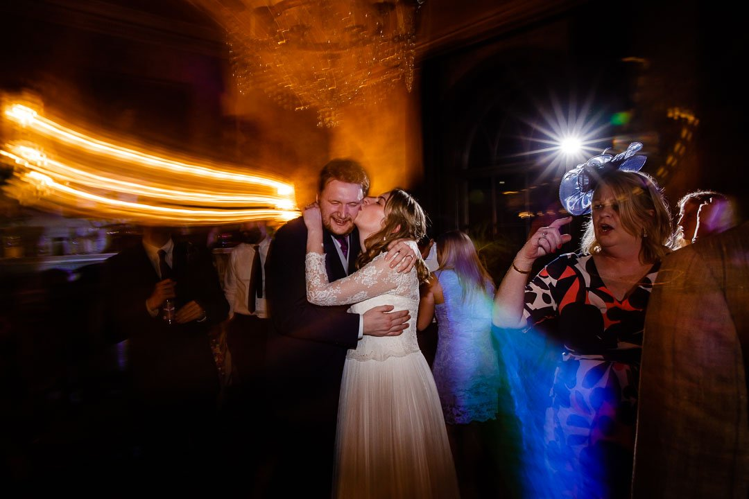 bride and groom kiss on the dance floor