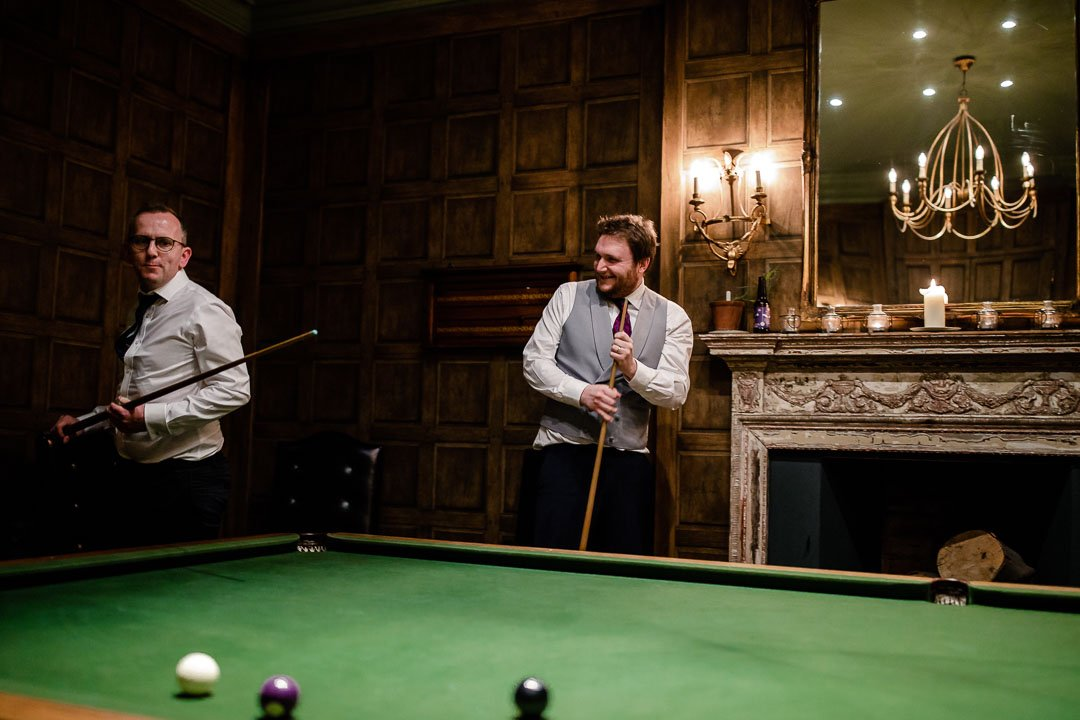 Groomsmen play snooker