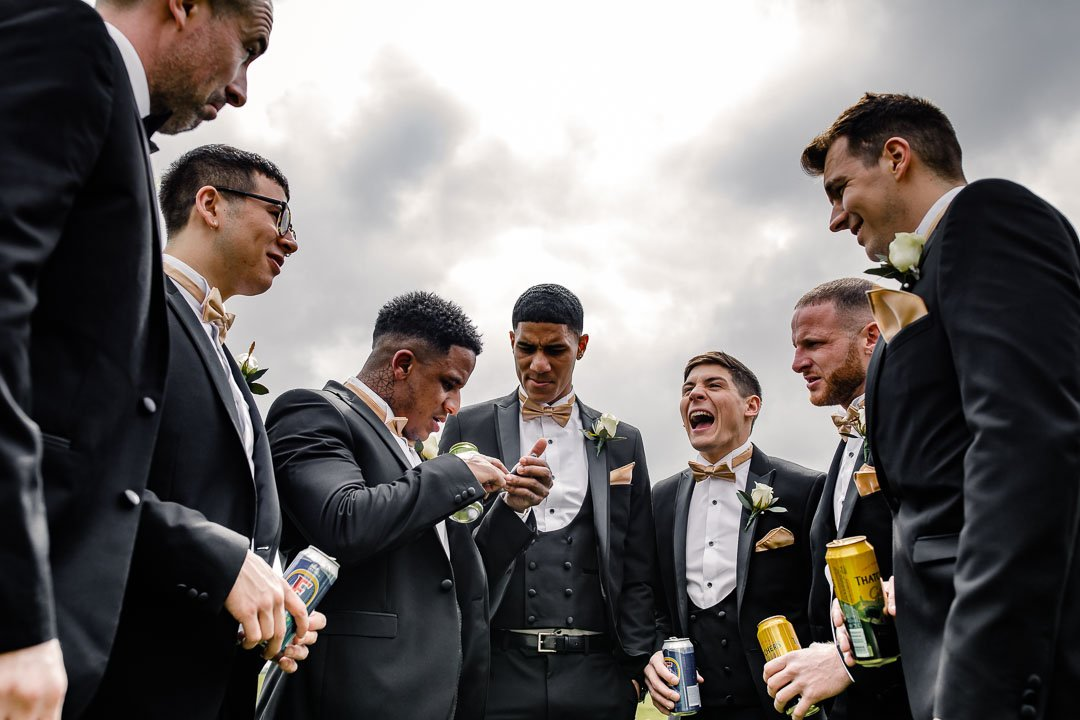 Kingscote Barn Tetbury laughing groomsmen