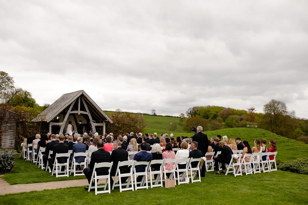 wide angle of the ceremony Kingscote Barn Tetbury