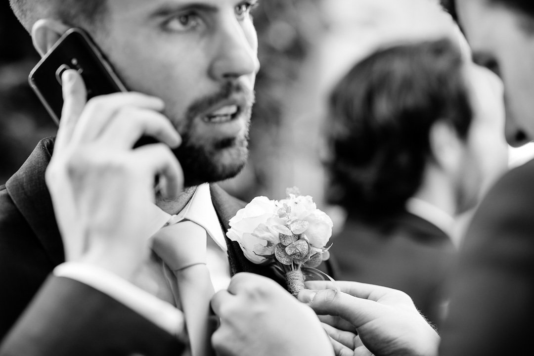 Groom makes a phone call