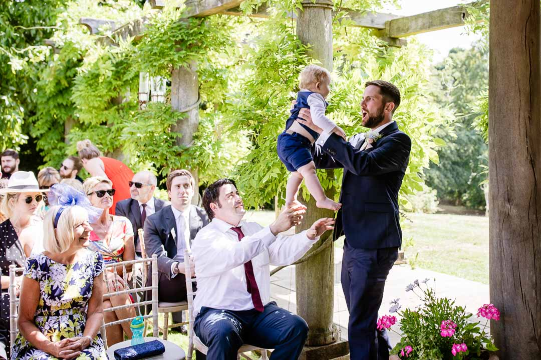 Groom plays with a baby