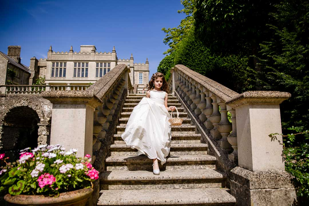 Bridesmaid coming down the steps