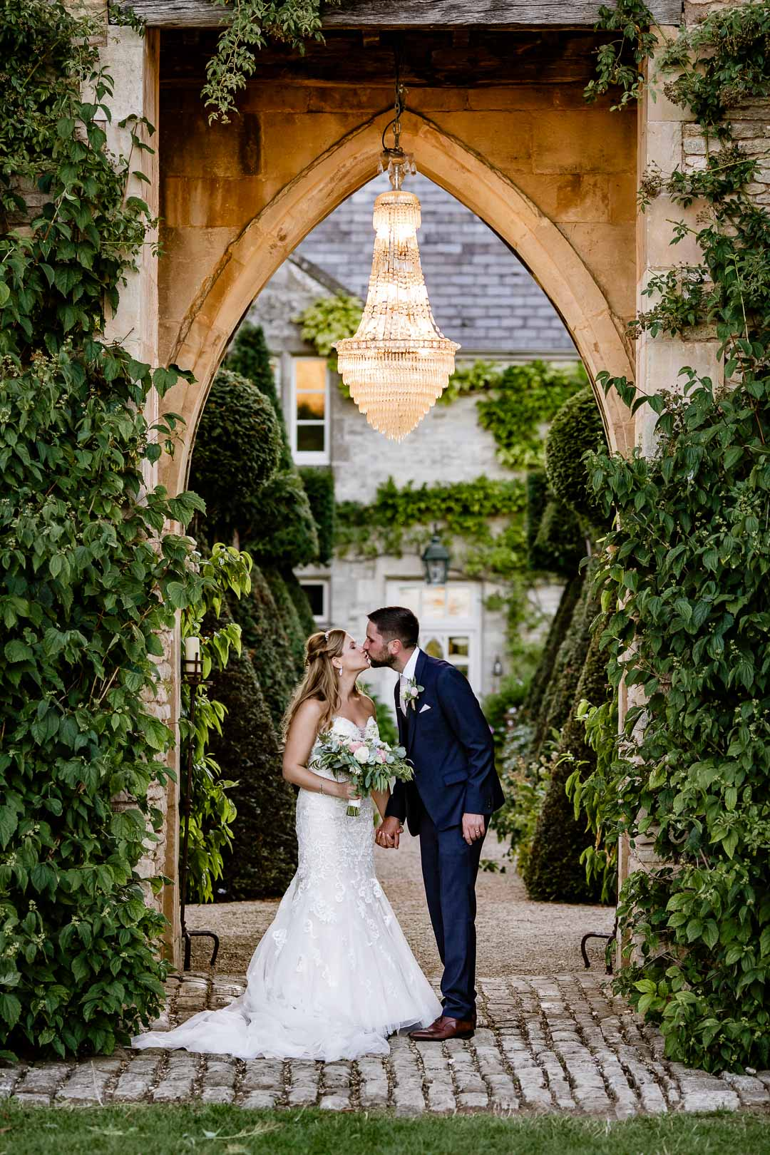 Kiss under the arch at The Lost Orangery