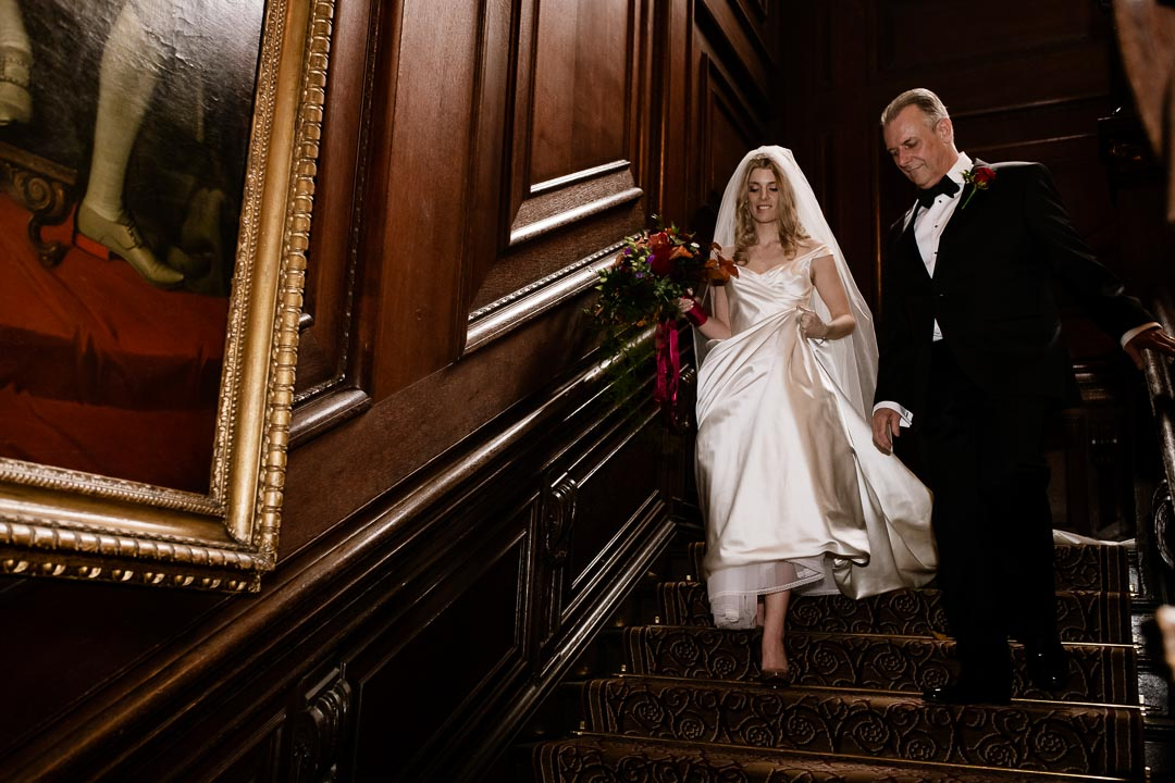 Bride and father on the stairs at Cliveden House