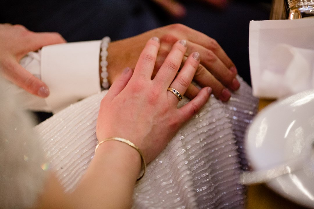 hand together with wedding rings