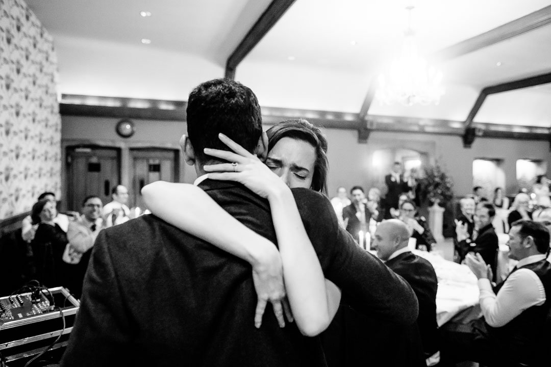 Bride hugs her husband