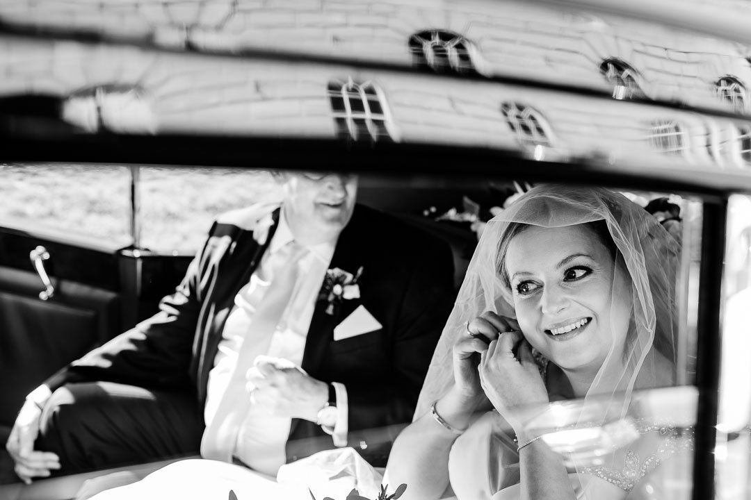 Riding in the bridal car with Brides Father