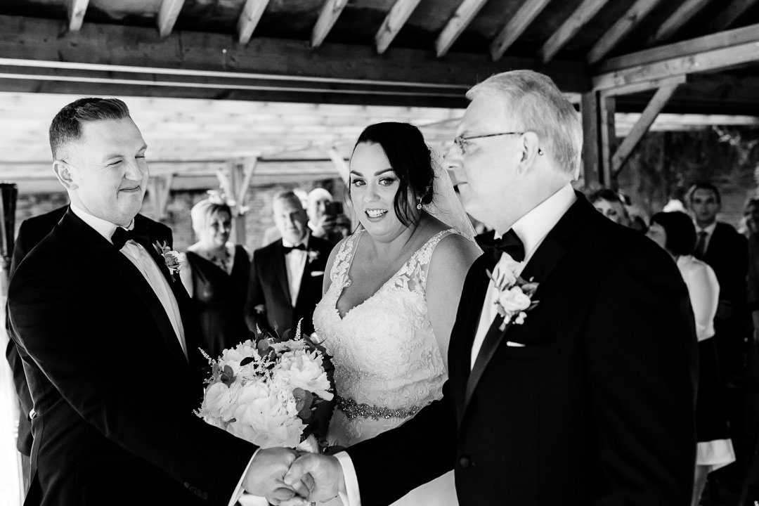 Father hands over the bride