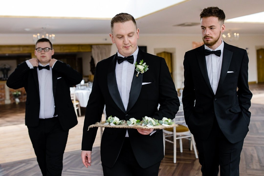 Groomsmen holding the buttonholes