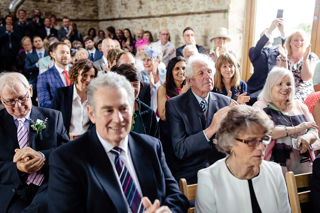 wedding guests clapping Old Barn Kelston
