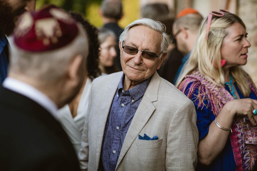 Jewish wedding guest mingling