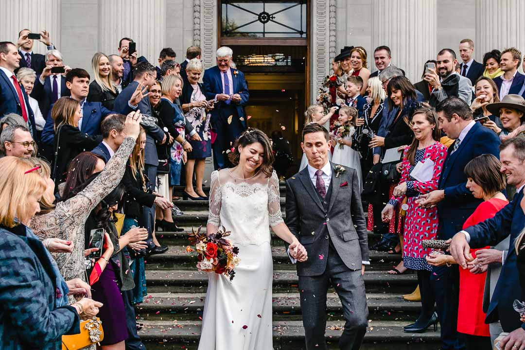 bride and groom leave town hall